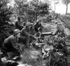 Vickers_machine-guns_fire_in_support_of_troops.jpg