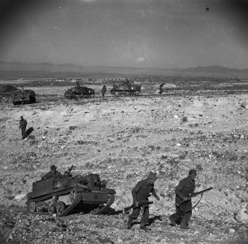 Infantry and carriers of the Grenadier Guards, near the Kasserine Pass, 24 February 1943; IWM NA 880