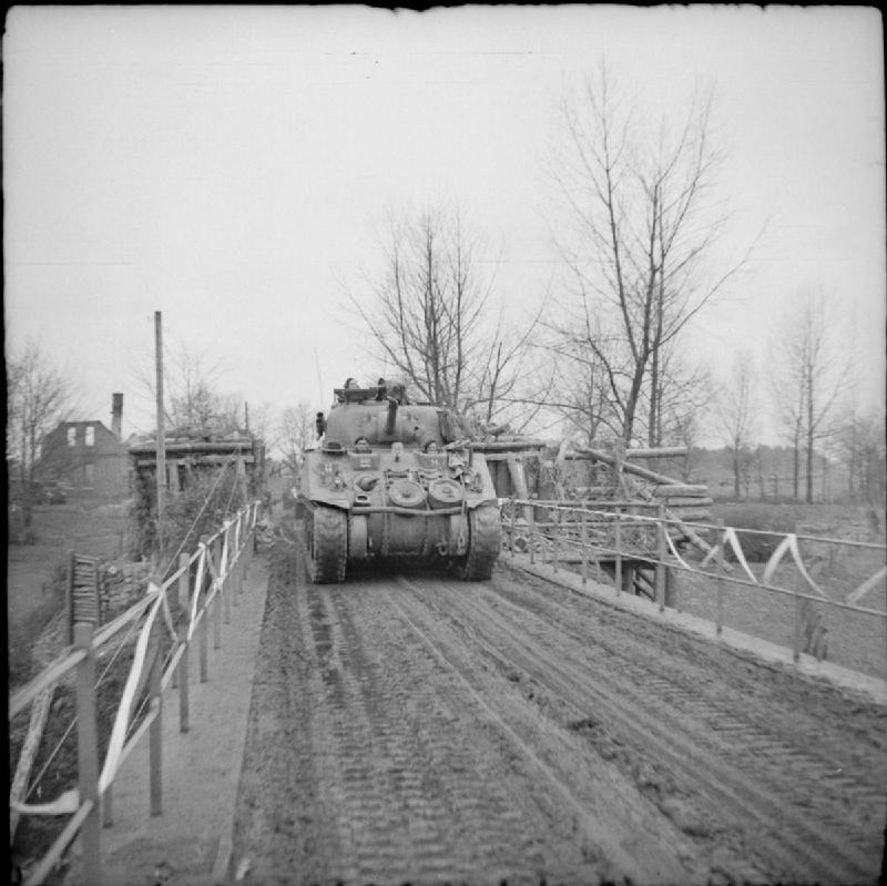 Sherman tanks of Guards Armoured Division crossing a bridge over the River Ems, 6 April 1945; IWM BU 3169